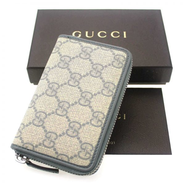 Authentic, New, and Unused Gucci Beige Blue GG Coated Canvas Card Case Wallet 255452 top view with gucci box
