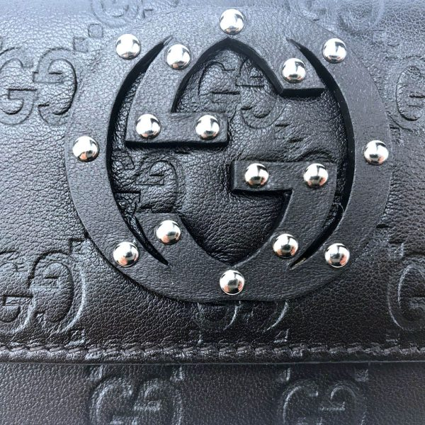 Authentic, New, and Unused Women's Gucci Calfskin Studded Soho Continental Wallet Black 231843 studded GG logo close-up