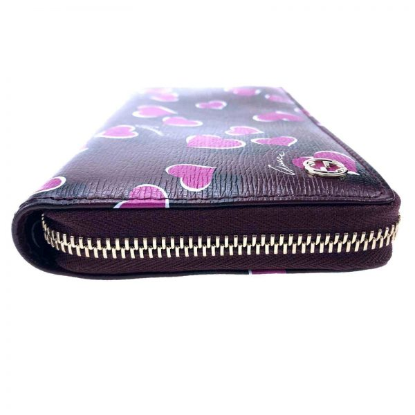 Authentic, New, and Unused Women's Gucci Magenta Heartbeat Print Leather Zippy Long Wallet 309705 left side view