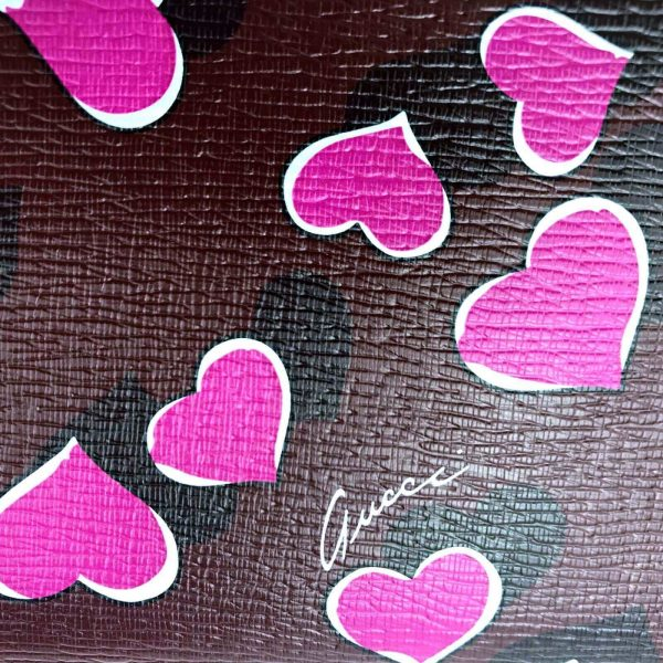 Authentic, New, and Unused Women's Gucci Magenta Heartbeat Print Leather Zippy Long Wallet 309705 hearts leather close-up