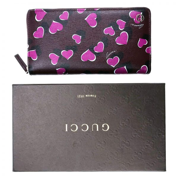 Authentic, New, and Unused Women's Gucci Magenta Heartbeat Print Leather Zippy Long Wallet 309705 top view with gucci box