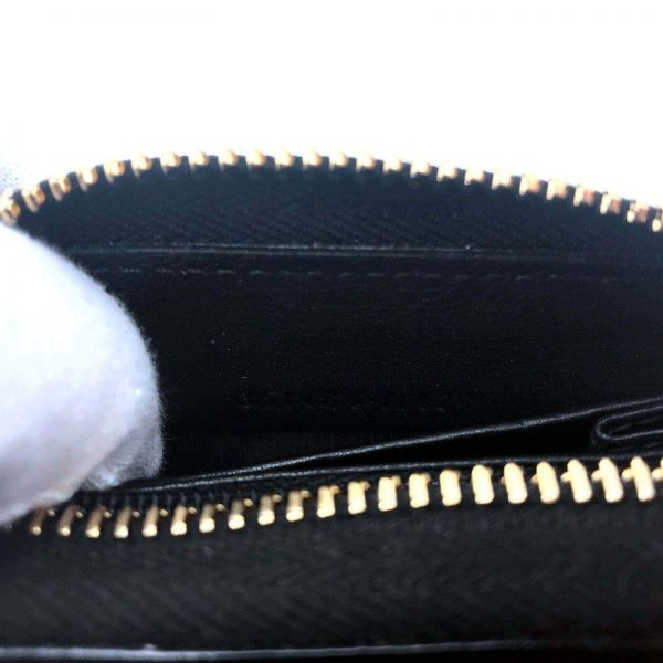 Authentic, New, and Unused Women's Gucci Nubuck Soho Disco Zip Around Wallet Black 351484 interior serial number close-up