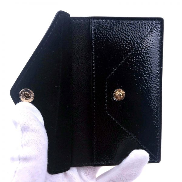 Authentic, New, and Unused Gucci Textured Patent Soho Envelope Card Case Wallet Black 337945 side view