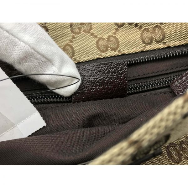 Authentic, New, and Unused Gucci Monogram Web Messenger Bag Brown 146309 interior serial number close-up
