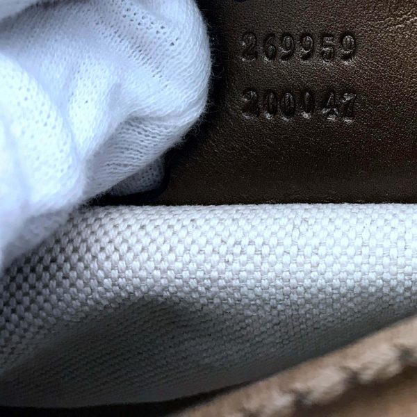 Authentic, New, and Unused Gucci Gold GG Bit Hobo Brown Canvas Satchel Bag 269959 interior serial number close-up