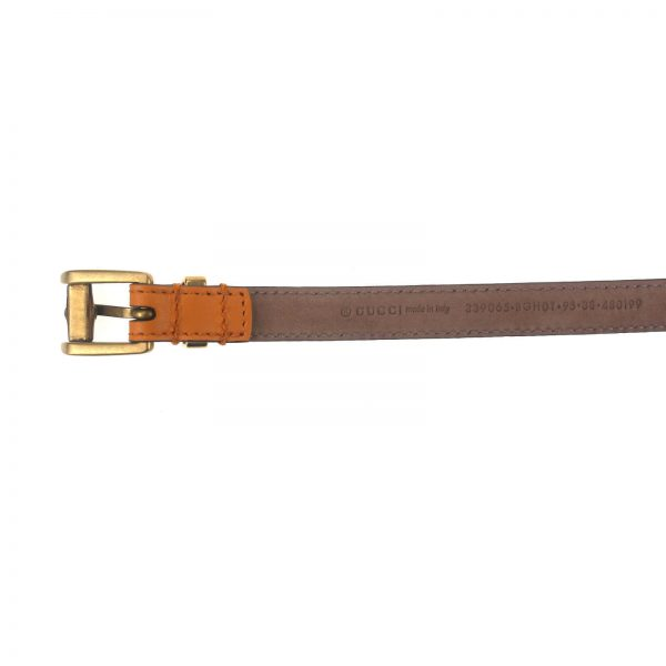 Authentic, New, and Unused Gucci Leather Bamboo Skinny Buckle Belt Orange 95B 339065 bottom view with serial number