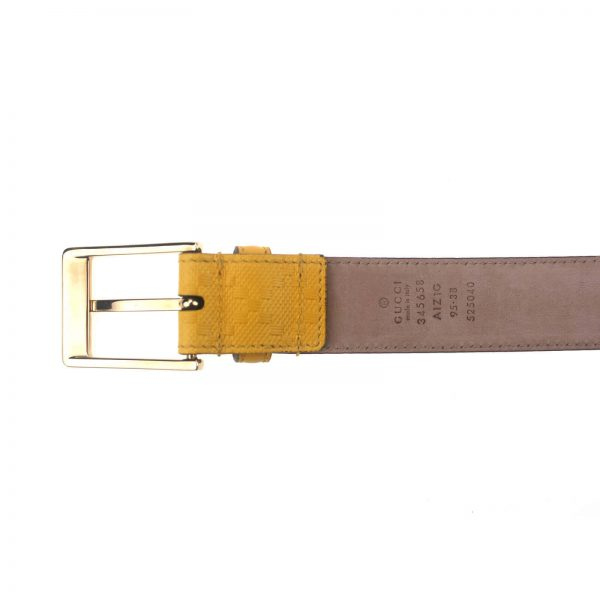 Authentic, New, and Unused Gucci Leather Diamante Square Buckle Belt Yellow 95B 345658 bottom view with serial number