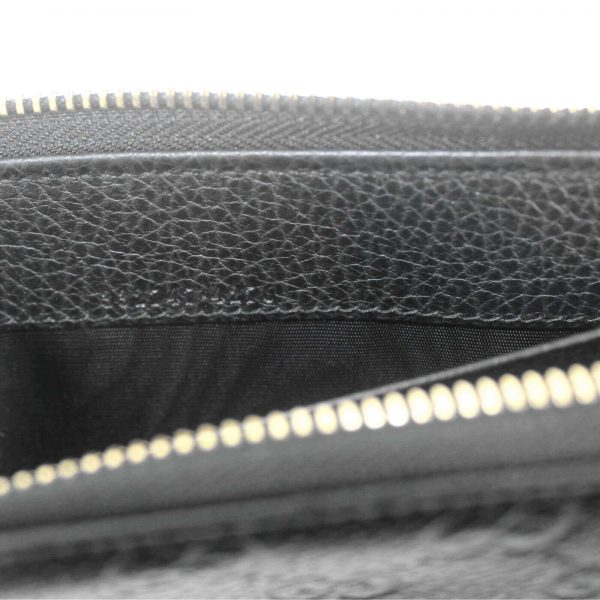 Authentic, New, and Unused Gucci Black Leather GG Guccissima Zip Coin Wallet 332747 interior stamped serial number