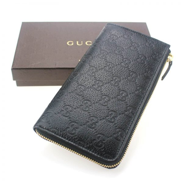 Authentic, New, and Unused Gucci Black Leather GG Guccissima Zip Coin Wallet 332747 interior stamped serial number top view