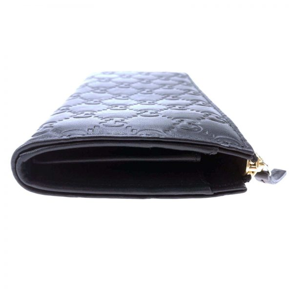 Authentic, New, and Unused Gucci Soft Black Leather GG Guccissima Zip Coin Wallet 332747 left side view
