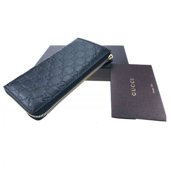 Authentic, New, and Unused Gucci Soft Black Leather GG Guccissima Zip Coin Wallet 332747 top view
