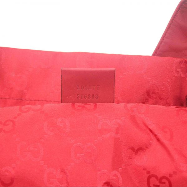 Authentic, New, Unused Gucci GG Nylon Viaggio Collection Tote Bag Red 308877 interior stamped serial number
