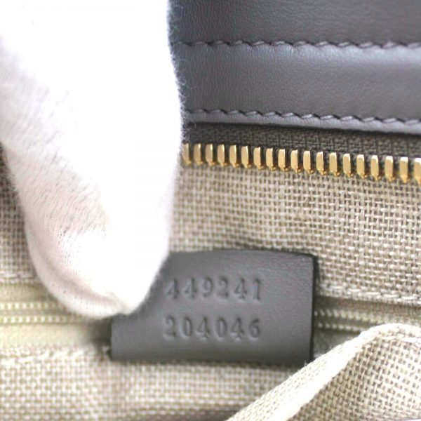 Authentic, New, and Unused Gucci Gray Microguccissima Small Crossbody Bag 449241 interior stamped serial number