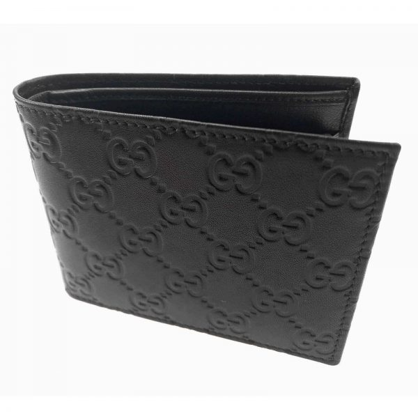 Authentic, New, and Unused Gucci Leather Guccissima Bifold Coin Pocket Wallet Black 143384 left side view