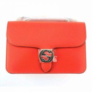 Authentic, New, and Unused Gucci Leather Interlocking GG Marmont Crossbody Purse Handbag Orange 510303 front view
