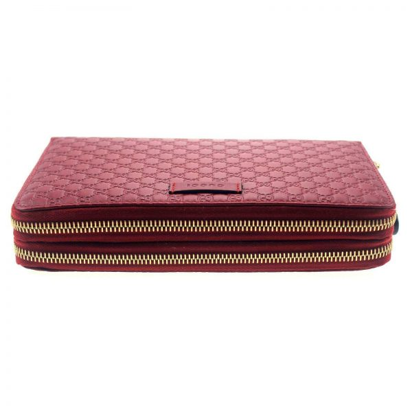Authentic, New, and Unused Gucci Red Leather Microguccissima Double Zip Travel Wallet 544250 bottom side view