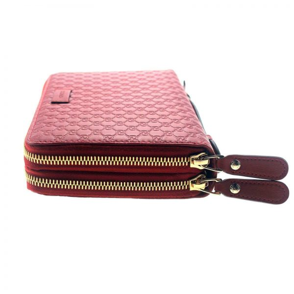 Authentic, New, and Unused Gucci Red Leather Microguccissima Double Zip Travel Wallet 544250 left side view