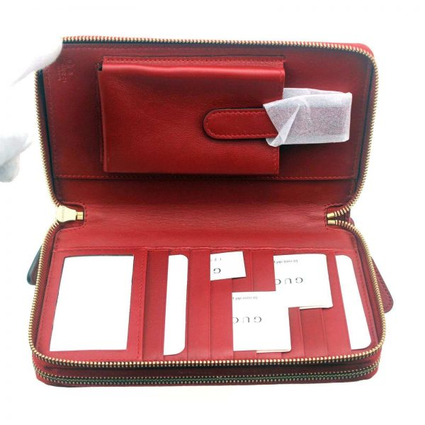 Authentic, New, and Unused Gucci Red Leather Microguccissima Double Zip Travel Wallet 544250 inside view