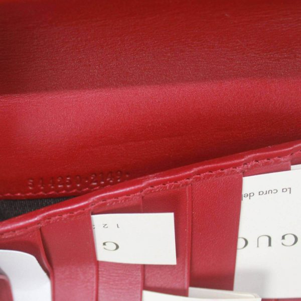 Authentic, New, and Unused Gucci Red Leather Microguccissima Double Zip Travel Wallet 544250 interior stamped serial number